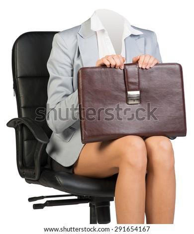 Woman body sitting in chair holding suitcase on isolated background