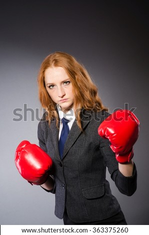 Woman boxer in dark room - stock photo