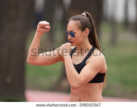 woman boxer training in the park