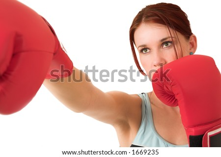 Woman boxing, depth of field. Face in focus, gloves out of focus.