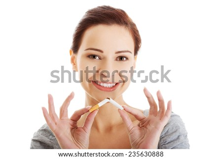 Woman breaks down the cigarette. - stock photo