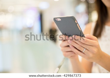 Woman browsing on phone