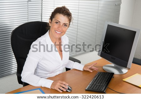 Woman brunette at office in a modern building