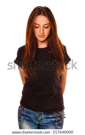 woman brunette girl looks down sad bored wearing a gray T-shirt and blue jeans isolated on white background - stock photo