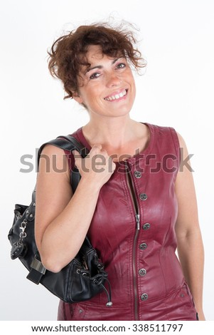 Woman brunette with a red leather dress isolated