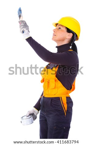 Woman builder in overalls and helmet 35-40 years old, doing paint wall, isolated on white