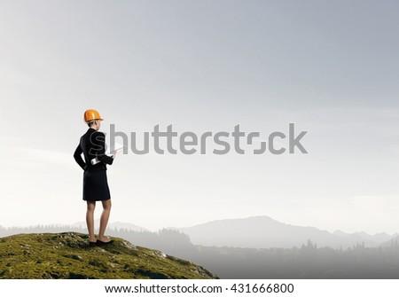 Woman builder on platform - stock photo