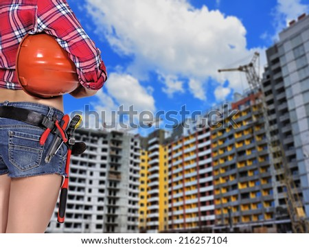woman builder with helmet  looking to building - stock photo