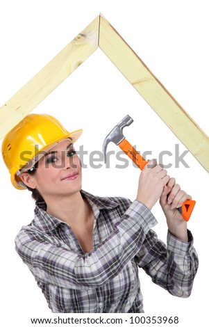 Woman building truss - stock photo
