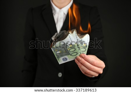 Woman burning  Euros closeup