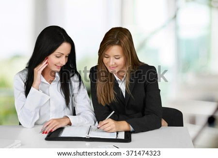 Woman business couple on table.