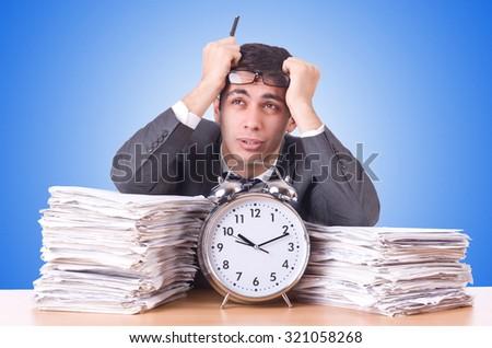Woman businessman with giant alarm clock - stock photo