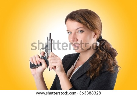 Woman businewoman with hand gun - stock photo