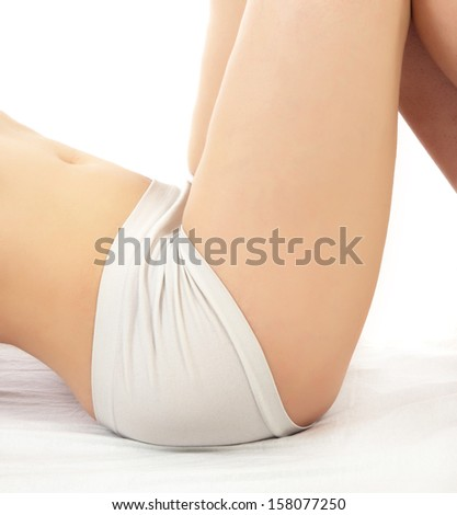 woman buttocks with pants on white