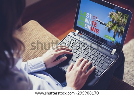 Woman buying a Last Minute Flight on the laptop. Italian flag design on the screen text. - stock photo