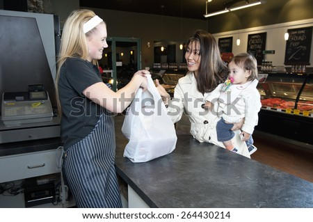 Woman Buying Groceries - stock photo