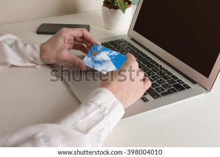 Woman buying on line with credit card. Online Purchase. - stock photo
