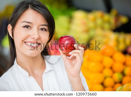 Woman buying organic apples at the supermarket - stock photo