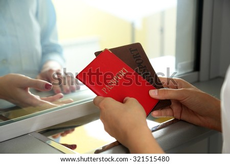 Woman buying tickets with passports at box office