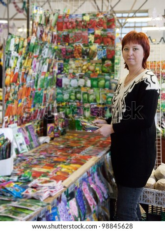 woman buys the seeds on the market - stock photo