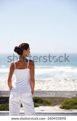 Woman by the sea - stock photo