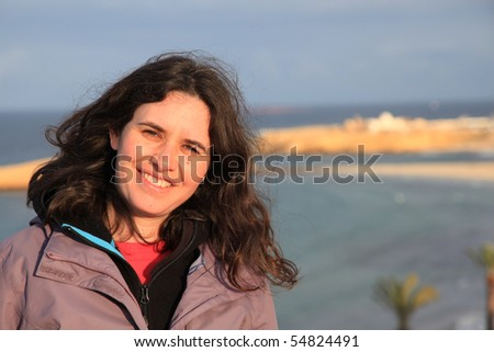 woman by the sea in Tunisia at sunset - stock photo