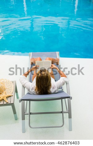 Woman by the swimming pool at the resort