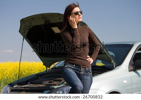 woman calling by mobile for help - stock photo