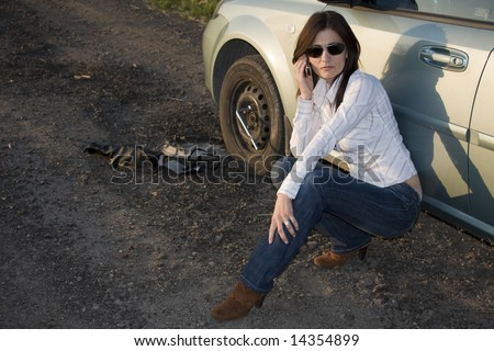 Woman calling for help from the road - stock photo