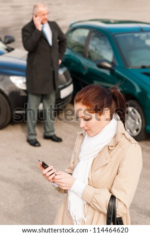 Woman calling insurance after car accident crash man trouble problem - stock photo