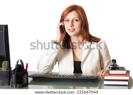 woman calling on the phone while sitting at a desk in an office on a white background isolated - stock photo