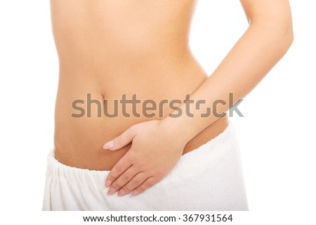 Woman cares about her belly. - stock photo
