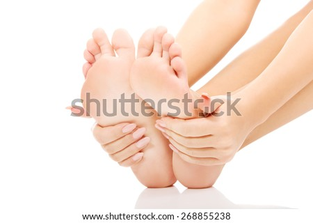 Woman cares about her feet. - stock photo
