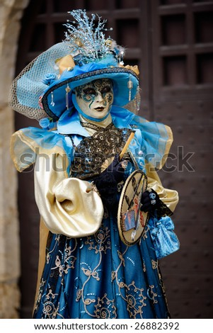 Woman carnival mask dressed in blue and gold (Annecy/France) - stock photo