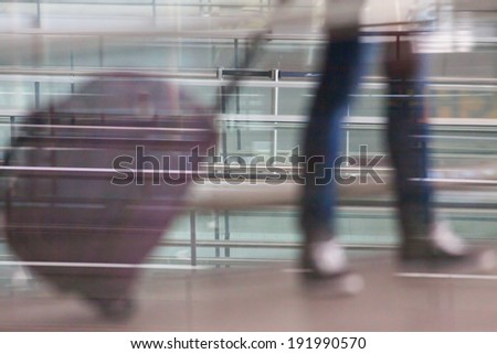 Woman carries your luggage at the airport terminal of Hong Kong - stock photo