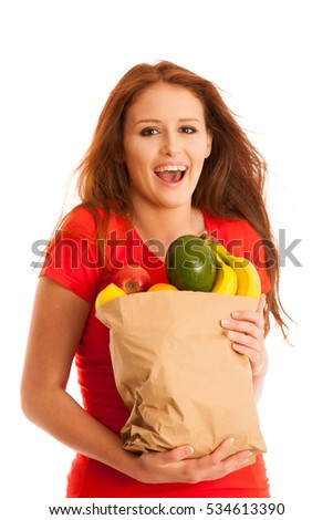woman carrying a bag full of various fruits isolated over white background