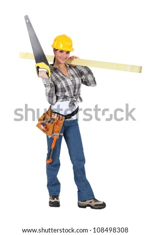 Woman carrying a handsaw and timber - stock photo