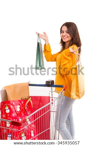 Woman carrying a shopping cart full of gifts