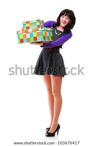 Woman carrying moving boxes. Young woman moving house to new home holding cardboard boxes isolated on white background standing in full length