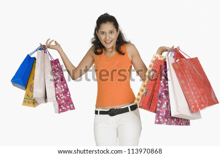 Woman carrying shopping bags - stock photo