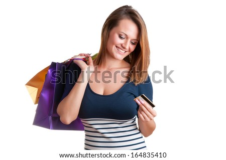 Woman Carrying Shopping Bags and holding a credit card isolated in a white background