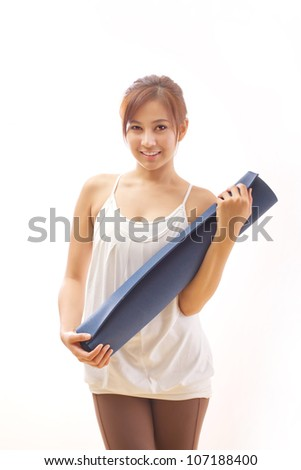 woman carrying yoga mat concept of happy and healthy fitness recreation - stock photo