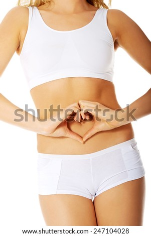 Woman carying about her belly - stock photo