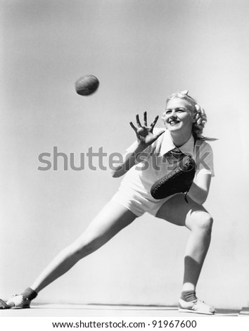 Woman catching a baseball - stock photo
