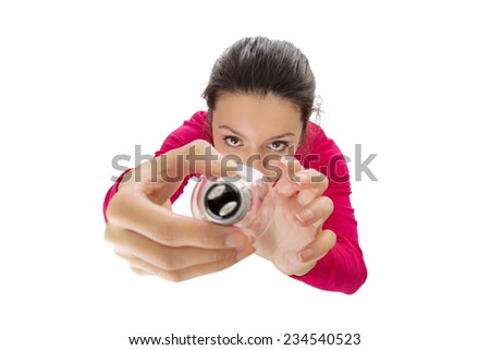 woman changing a light bulb shot from a birds eye  view looking down