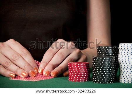 woman checking cards on texas holdem - stock photo