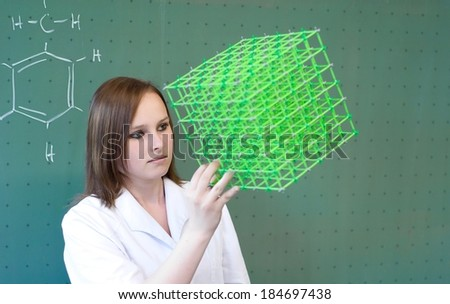 Woman checking in chemistry class a Model - stock photo