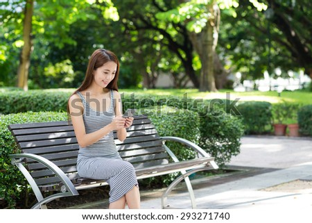 Woman checking message on cellphone - stock photo