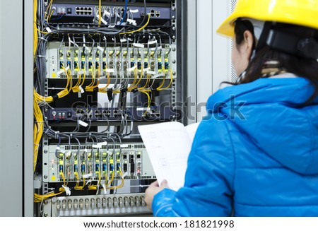 woman checking  network cables - stock photo