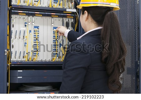 woman checking network cables